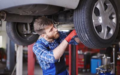 Volkswagen Mechanic Checking Rear Spring